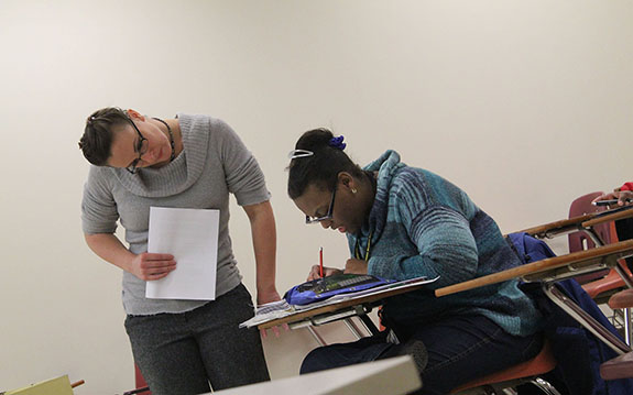 UMBC instructor working on a writing assignment with a student from the UMBC SUCCESS program.