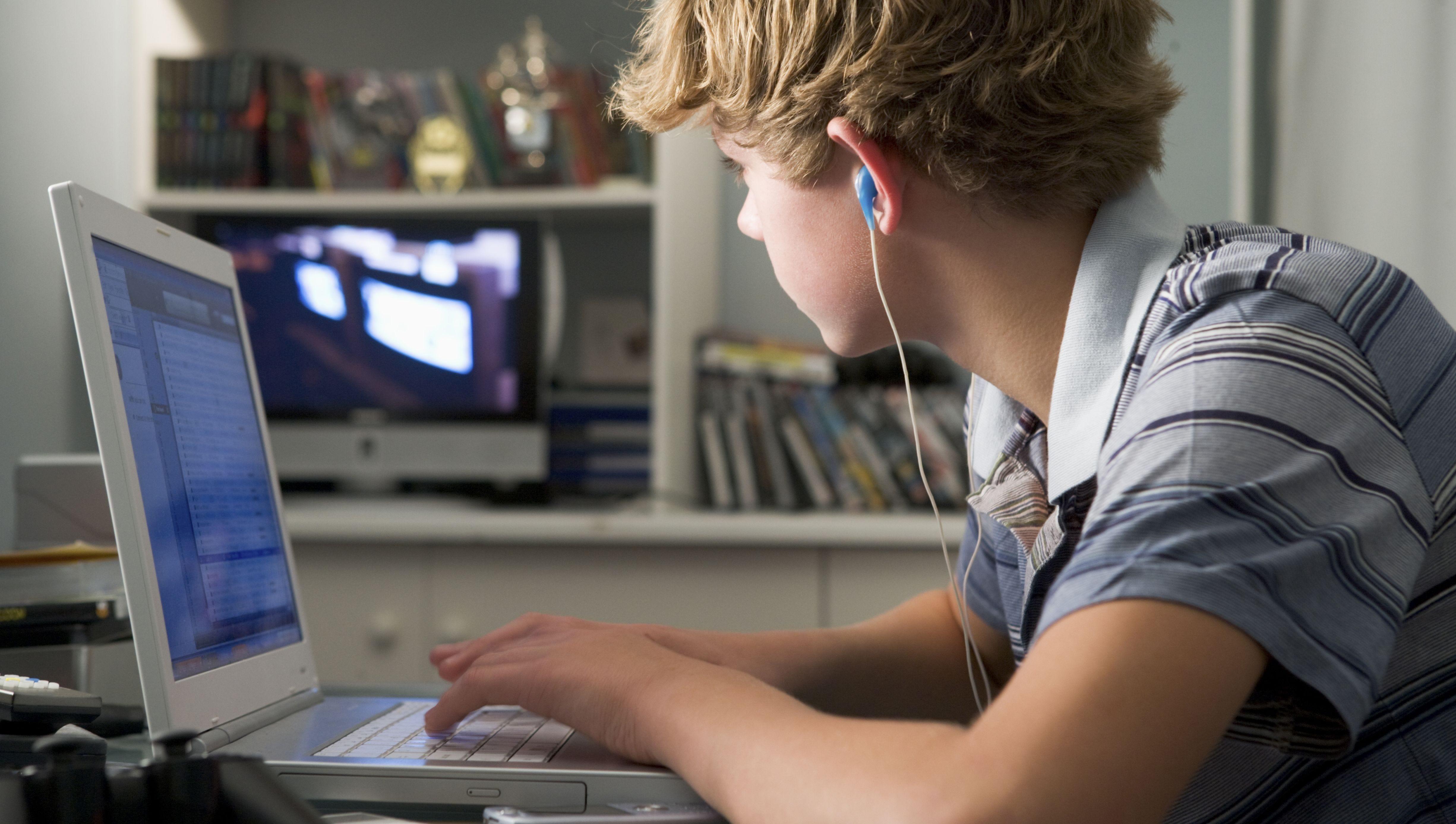Boy on a computer.