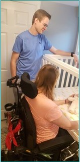 Mom in a wheelchair tucks baby safely into the crib