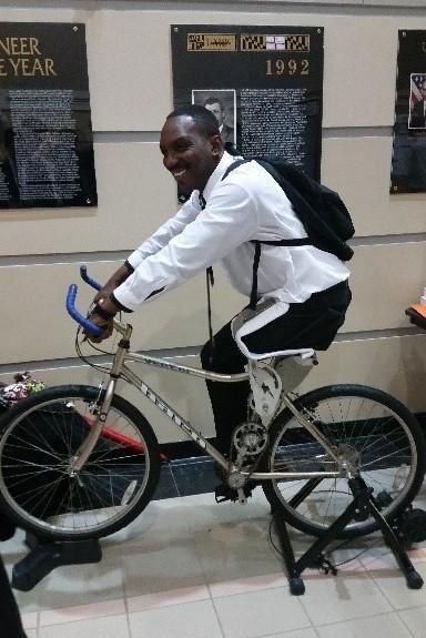 man riding a customized bike